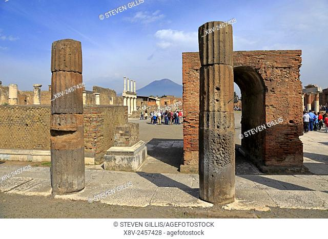Forum columns by the Public Administration buildings with Mount Vesuvius in the distance, Pompeii, Italy