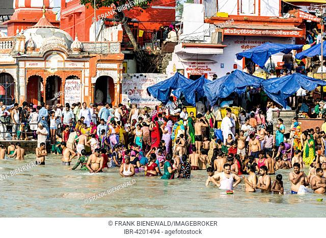 Masses of pilgrims are gathering for bathing at Harki Pauri Ghat at the holy river Ganges, Haridwar, Uttarakhand, India