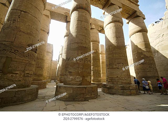 Carved pillars, Built in Yellow Limestone, View of the great hypostyle hall in the Precinct of Amon Re, Situated at Karnak Temple complex