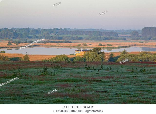 View of coastal freshwater wetland habitat, Island Mere from Whin Hill, Minsmere RSPB RSPB Reserve, Suffolk, England, may