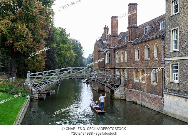 UK, England, Cambridge. Punting on the River Cam by the Mathematical Bridge, Queen's College