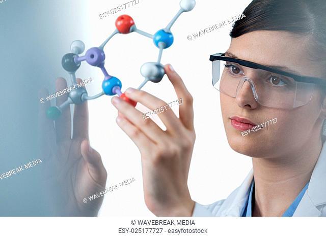 Female scientist holding molecular model