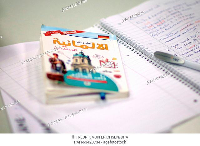 An Arabic-German book can be seen on a desk during an integration course for women within the scope of the project 'Work & Life' in Mainz,Germany