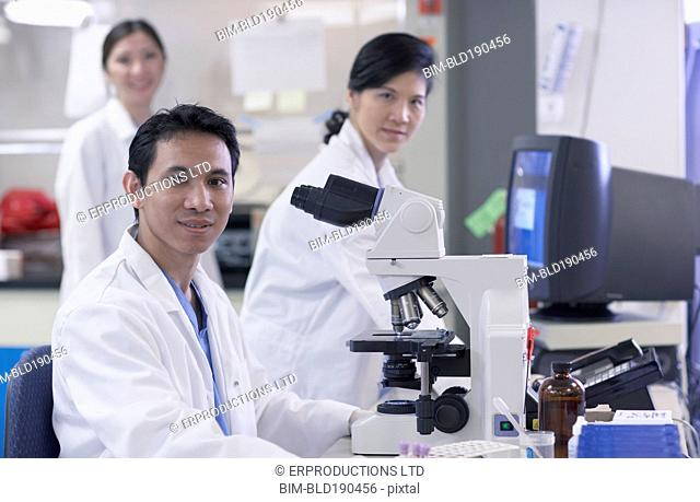 Asian scientists in laboratory