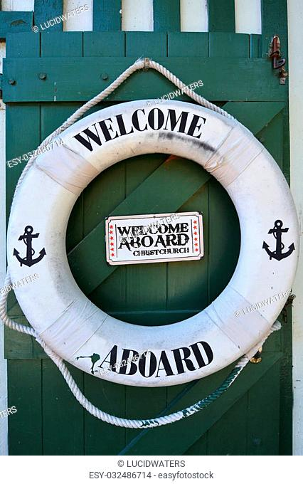 CHRISTCHURCH - DEC 04 2015:Welcome aboard sign on a life saving wheel of Punting on the Avon river Christchurch.It is an iconic tourist attraction of...
