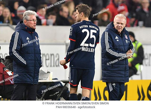 Thomas MUELLER (MULLER,FC Bayern Munich) with Jupp HEYNCKES (Trainer FC Bayern Munich,li) und Hermann GERLAND,Co Trainer FC Bayern Munich vor Einwechslung