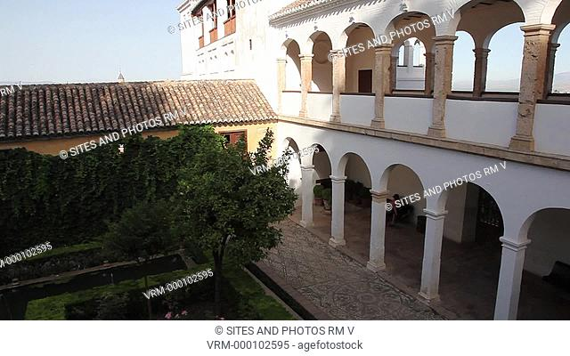 PAN, HA, exterior, daylight. The arcaded structure dates back to 1584. In front of it is an intimate court and a garden with a baroque flare to it