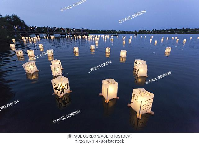 Seattle, Washington: Participants place paper lanterns in the lake at the From Hiroshima To Hope gathering at Green Lake Park