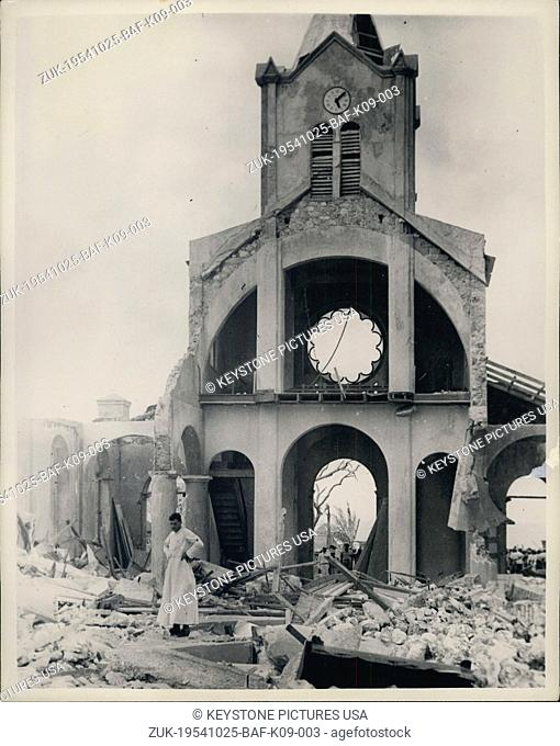 Oct. 25, 1954 - Hurricane Wrecks Haiti Coastal Town - Many Dead. French Priest Gazes At Church Ruins. Many people lost their lives when a Hurricane - with 115...
