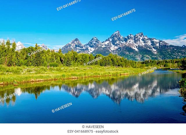 Grand Teton Mountains from Schwabacher's Landing on the Snake River at morning. Grand Teton National Park, Wyoming, USA