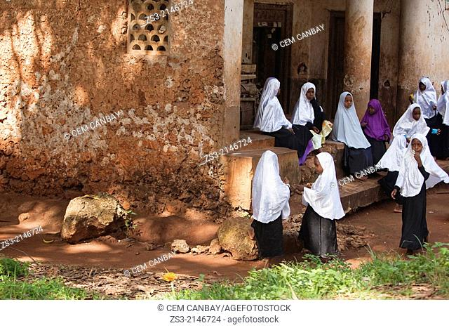 Muslim girls with white headscarf at the entrance of the school, Nungwi village, Zanzibar Island, Tanzania, East Africa