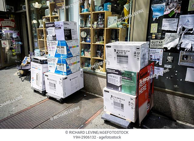 A selection Frigidiaire and Friedrich air conditioners outside of a hardware store in New York