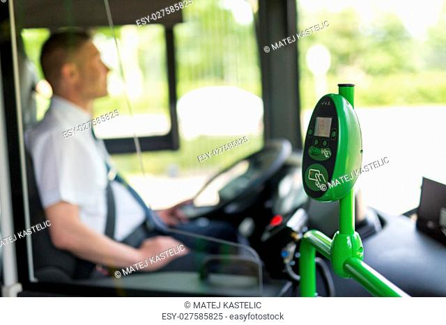 Modern prepayed public transport ticketing system with validation machine at entranse of bus