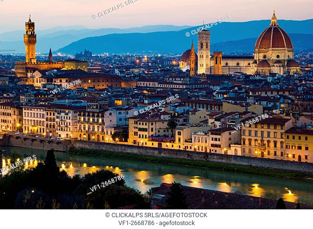Florence, Tuscany, Italy. Cytiscape with the Cathedral and the Brunelleschi Dome, Giotto Tower at sunset, lights on