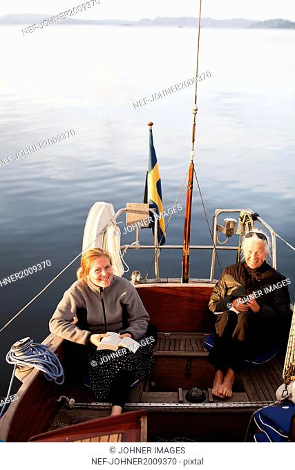 Grandmother and granddaughter on boat