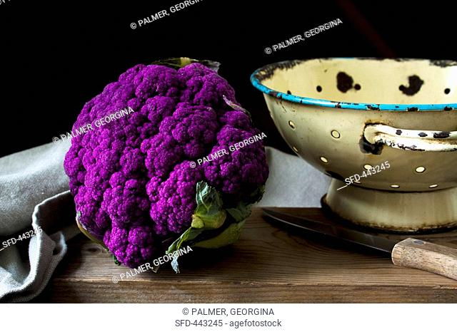 Purple cauliflower on wooden table