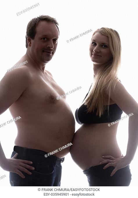 Pregnant Woman and her Partner Measuring Bellies