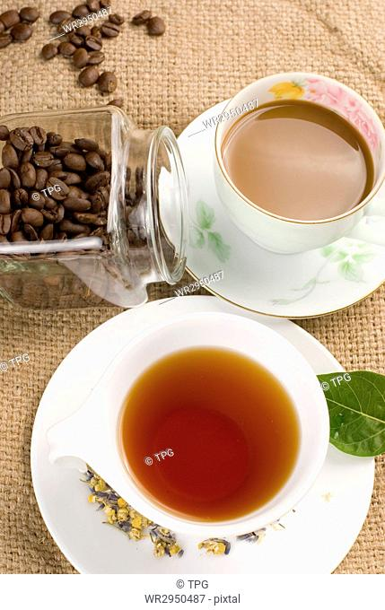 coffee, coffee beans and tea with green leaf