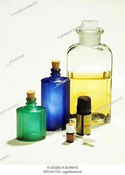 Sandlewood essential oil, storage bottles behind