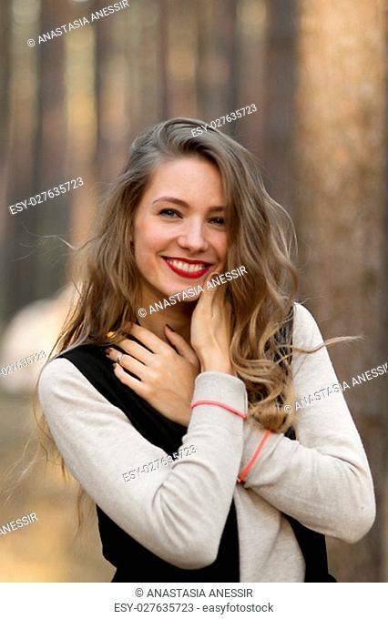 Attractive cheerful smiling happy lucky beautiful girl with beautiful white cute healthy nice smile.Portrait of beautiful girl with cute smile