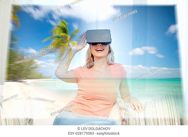 technology, augmented reality, cyberspace, entertainment and people concept - happy young woman wearing virtual headset or 3d glasses with exotic tropical beach...