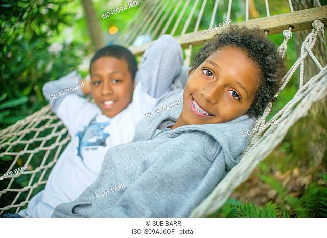 Boys lying in a hammock