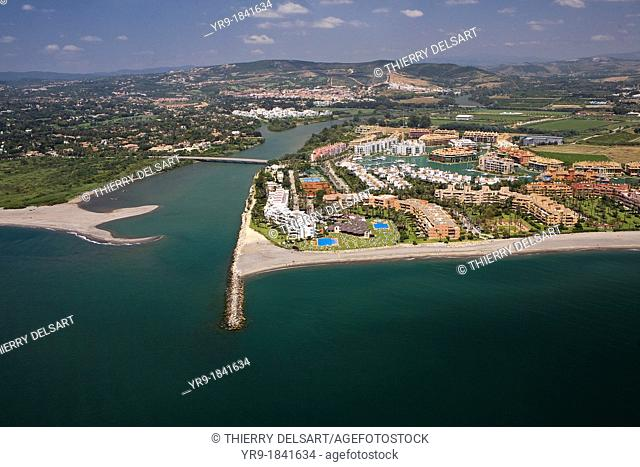 Aerial view of Sotogrande's marina  Guadiaro river's mouth, golfs and polo courts behind  Gibraltar's Strait area, Spain