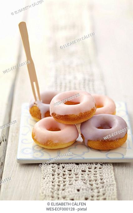 Glazed baked doughnuts on tile