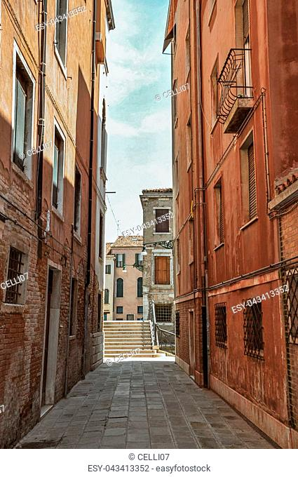 View of old buildings in an alley and bridge in the city center of Venice, the historic and amazing marine city. Located in Veneto region, northern Italy