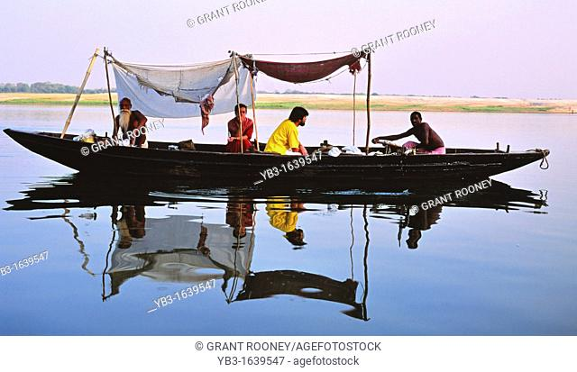 Tourists take a boat trip on the River Ganges, Varanasi, Uttar Pradesh, India