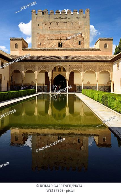 Courtyard of Myrtles pool with Comares Tower reflection in Nasrid Palaces Alhambra Granada