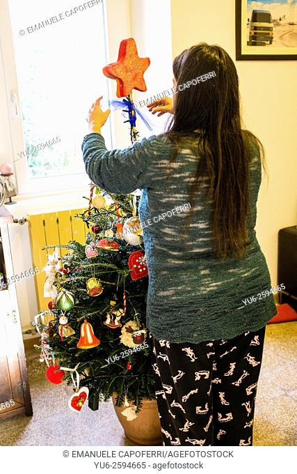 Woman preparing the Christmas tree at home