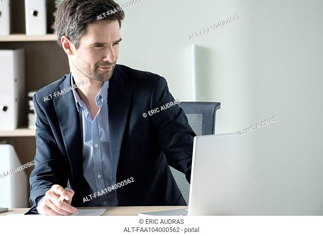 Entrepreneur using laptop