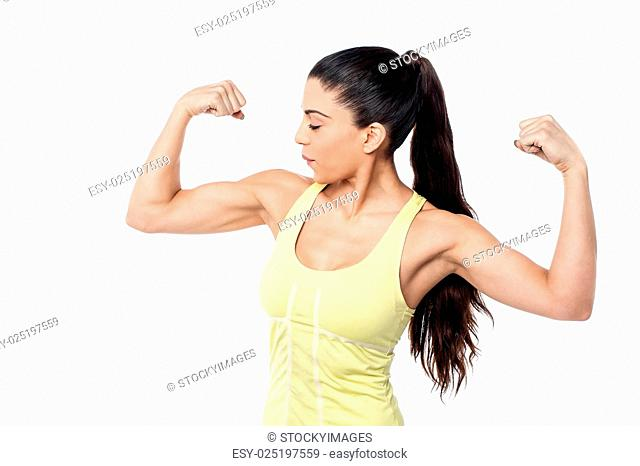 Muscular woman showing biceps