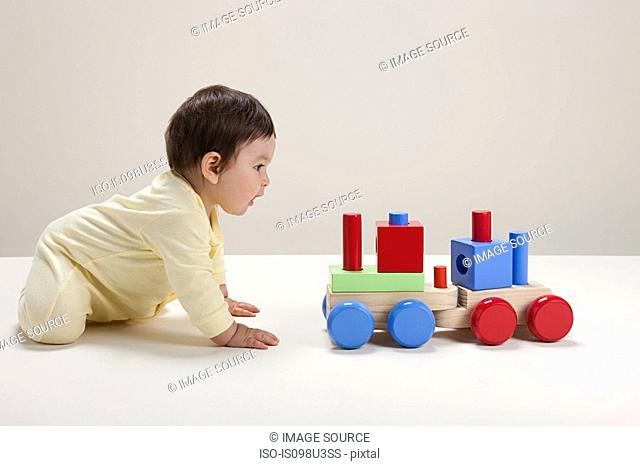 Baby boy playing with toy train