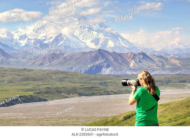 Female photographing the view from the Eielson Visitor Center with Denali (Mt. McKinley) in Denali National Park and Preserve, Interior Alaska, Summer, HDR