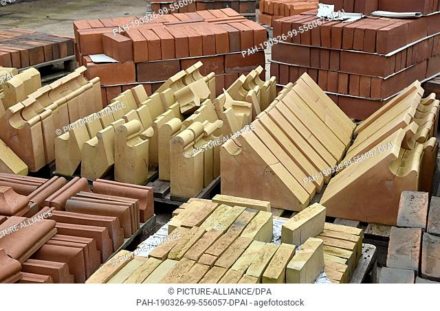 26 March 2019, Brandenburg, Glindow: Various bricks stand in the courtyard of the brick factory. The company with 20 employees produces bricks and ceramics to...