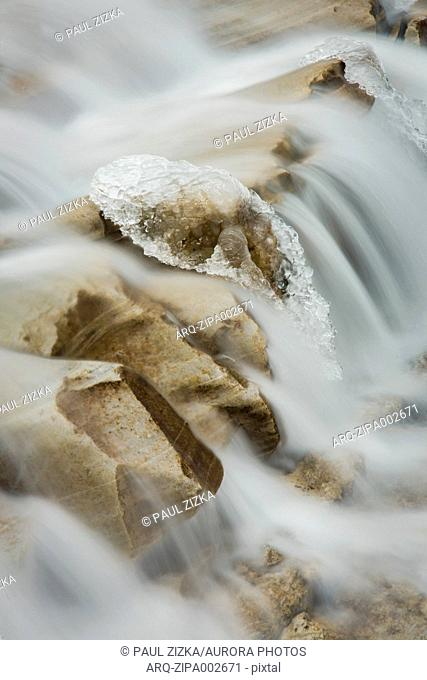 Close up of flowing water and ice in winter in Johnston Canyon, Banff National Park, Alberta, Canada