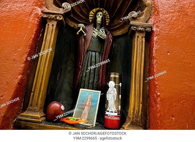 A figurine of Santa Muerte (Saint Death) seen in a temple in the historical center of Mexico City, Mexico, 27 May 2011. The religious cult of Santa Muerte is a...