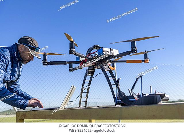 Professional drone before a flight being configured by operator