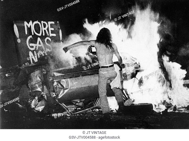 Gas Shortage Demonstrator in Front of Burning Car During Riot at Night, Levittown, Pennsylvania, USA, 1979