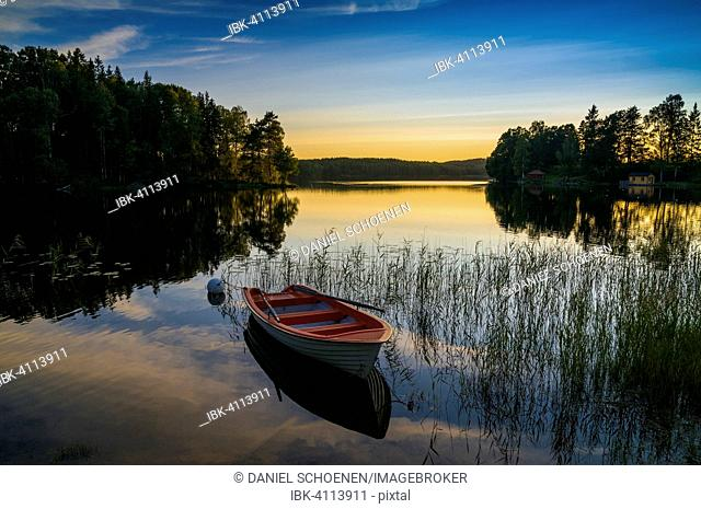 Lake and rowing boat at sunset in Bengtsfors, Dalsland, Sweden