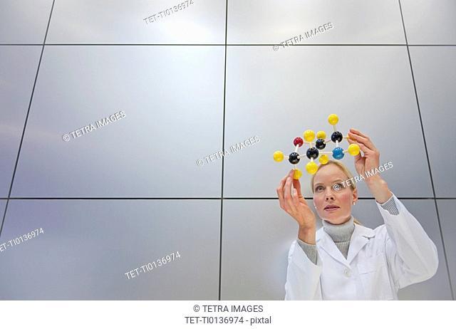 Reeacher holding molecular model