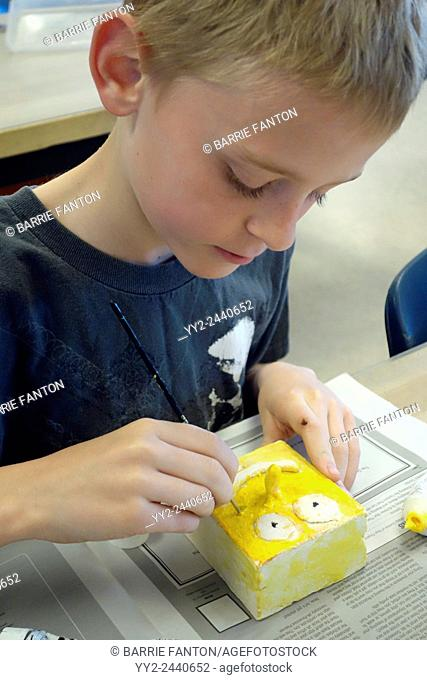 6th Grade Boy Working on Art Project, Wellsville, New York, United States