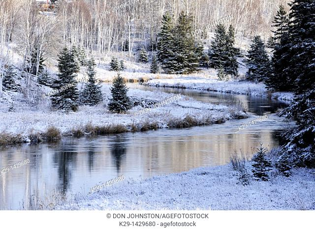 A dusting of early snow on the shoreline of Junction Creek Greater Sudbury Ontario