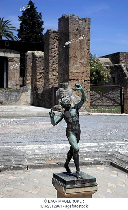 House of Faun, a bronze statue of the dancing forest god Faun in front of it, Pompeii, Campania, Italy, Europe