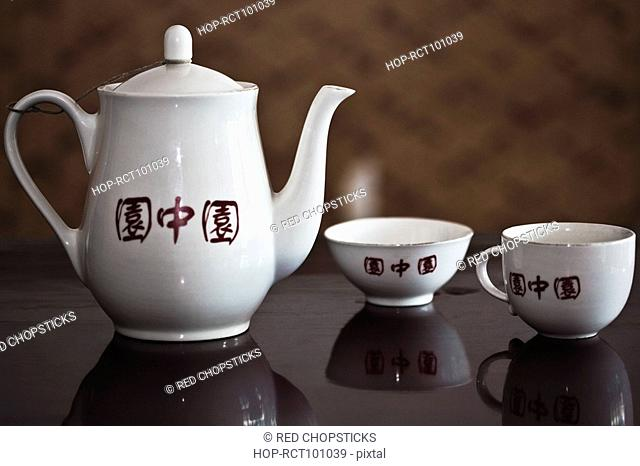 Close-up of a teapot with teacups, HohHot, Inner Mongolia, China