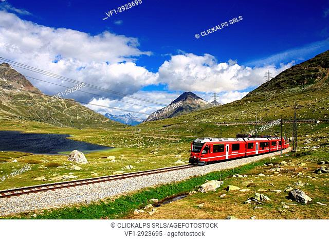 Bernina Pass with bernina express near at blak lake, Graubünden, Switzerland