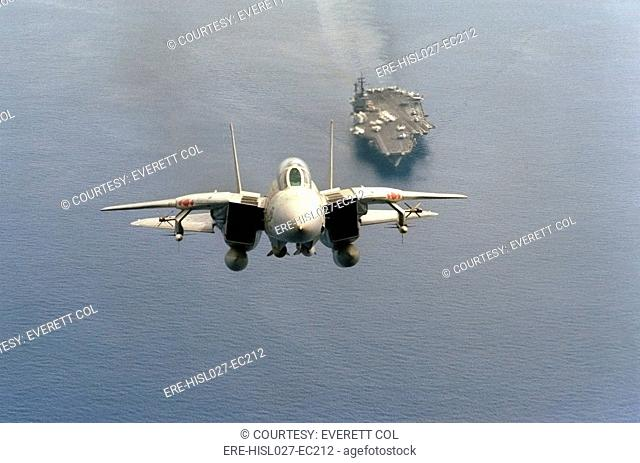 F-14 Tomcat fighter just after take-off from the aircraft carrier USS AMERICA is armed with missiles mounted on wing pylons. 1984. BSLOC-2011-12-214