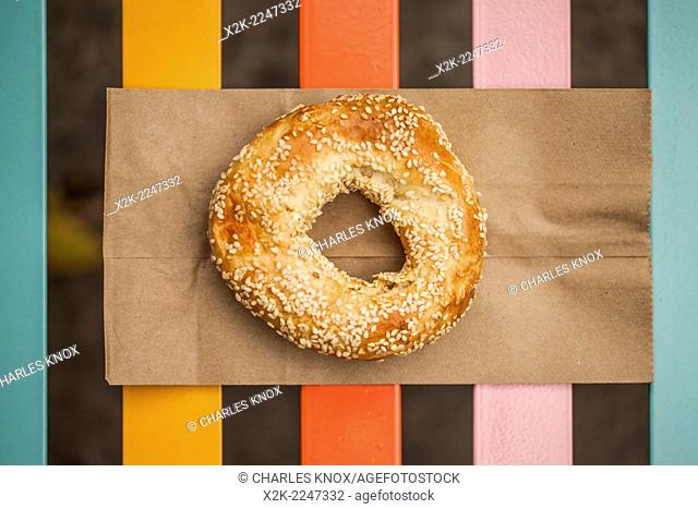 Authentic Montreal style sesame bagel on paper bag, Montreal, Quebec, Canada
